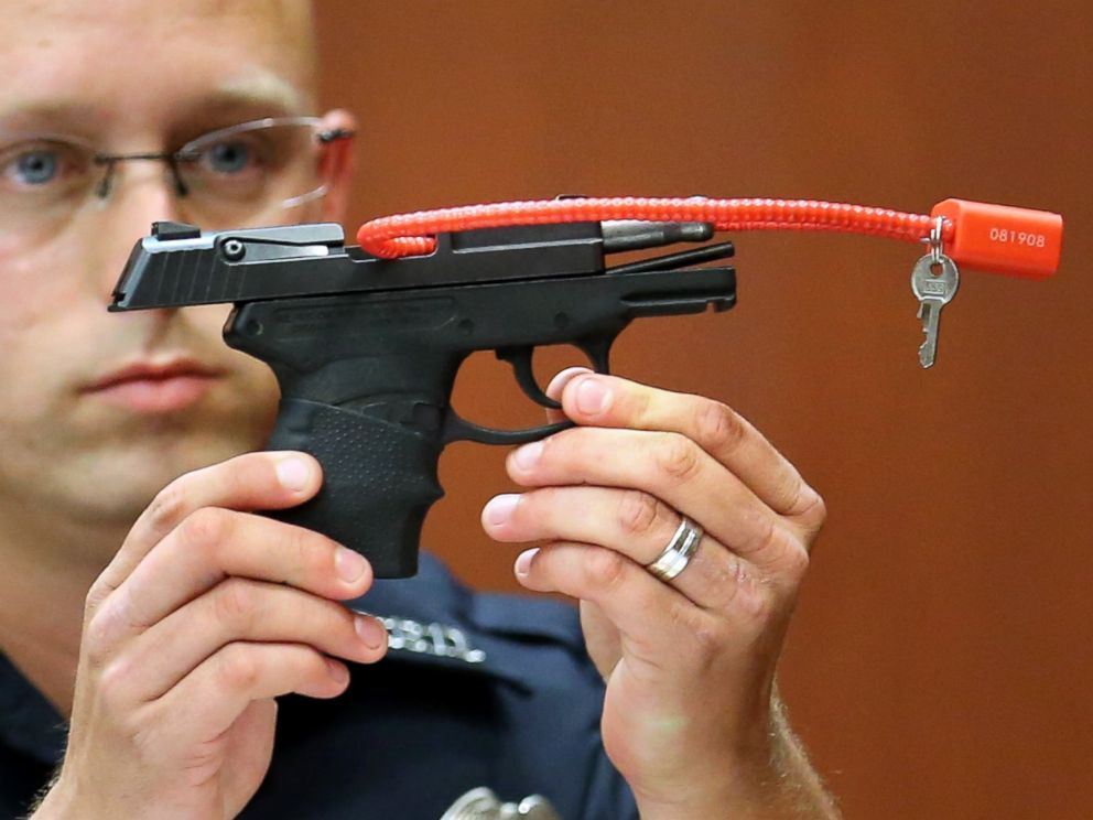 PHOTO: Sanford police officer Timothy Smith holds up the gun that was used to kill Trayvon Martin, while testifying on the 15th day of the George Zimmerman murder trial in Seminole circuit court June 28, 2013 in Sanford, Florida.