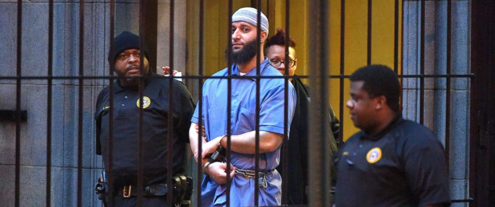 """PHOTO: Officials escort """"Serial"""" podcast subject Adnan Syed from the courthouse following the completion of the first day of hearings for a retrial in Baltimore, Feb. 3, 2016."""