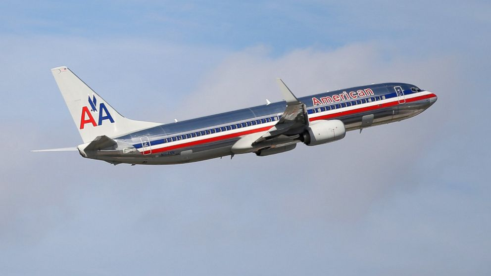 An American Airlines plane takes off from the Miami International Airport, Nov. 12, 2013 in Miami.