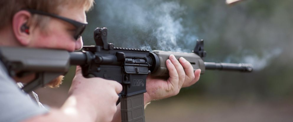 PHOTO: Smoke rises from the barrel of an AR-15 assault rifle.