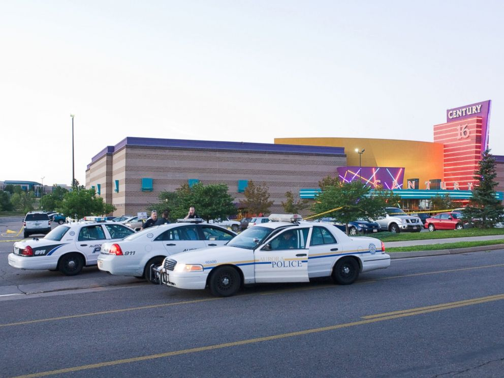 PHOTO: Police cars are seen in the parking area around the Century 16 movie theater in Aurora, Colo., July 20, 2012 where a gunman opened fire during the showing of the new Batman movie.
