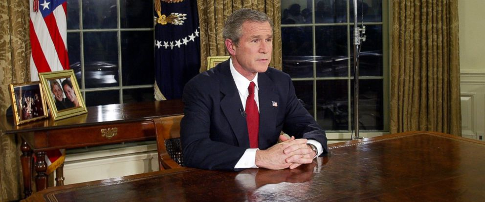 PHOTO: Then President George W. Bush addresses the nation, March 19, 2003, in the Oval Office of the White House in Washington.