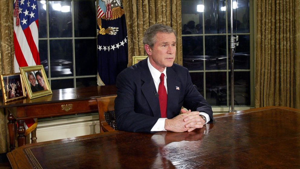 Then President George W. Bush addresses the nation, March 19, 2003, in the Oval Office of the White House in Washington.