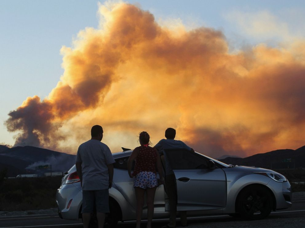 PHOTO: People watch the so-called Blue Cut wildfire in Lytle Creek, California, Aug. 16, 2016.