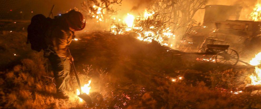 PHOTO: A firefighter battle the Blue Cut wildfire near Cajon Pass, north of San Bernardino, California, Aug. 16, 2016.