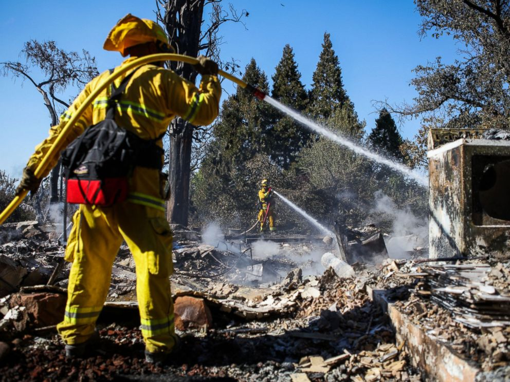 PHOTO: A firefighter works to contain embers on the remains of a house destroyed in the Clayton Fire are seen in Lower Lake, California, Aug. 15, 2016.