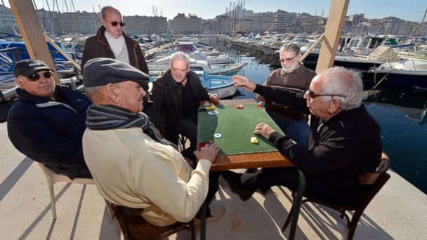 "PHOTO: Men play cards, January 7, 2013, in the Vieux Port of Marseille (Marseilles old harbor), southern France, a week before the launching, January 12, 2013, of ""Marseille-Provence European Capital of Culture"" in 2013."