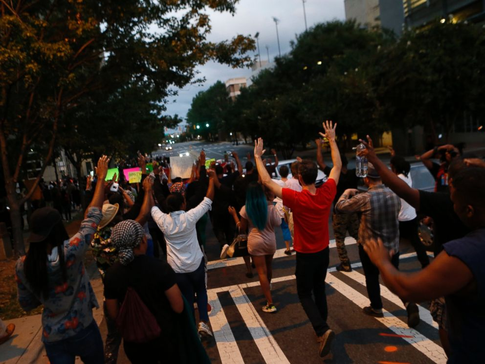 PHOTO: Residents gather for a vigil and march to protest the death of Keith Scott Sept. 21, 2016 in Charlotte, North Carolina.