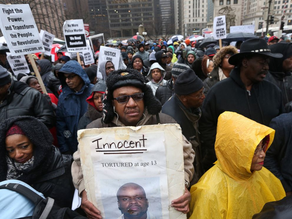 PHOTO: A collection of elected officials, community activists and labor leaders listen to a prayer before a demonstration billed as a march for justice along Michigan Avenue in Chicago, Nov. 27, 2015.