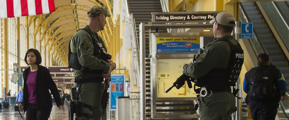 PHOTO: Heavily armed police patrol Ronald Reagan Washington National Airport in Arlington, Va., March 22, 2016.