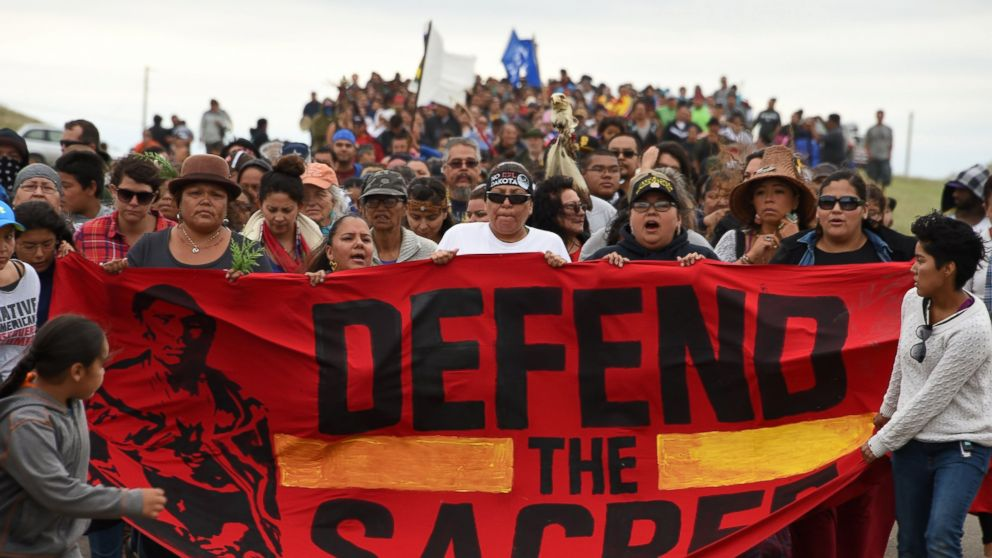 Native Americans march to a burial ground sacred site that was disturbed by bulldozers building the Dakota Access Pipeline (DAPL), Sept. 4, 2016 near Cannon Ball, North Dakota.