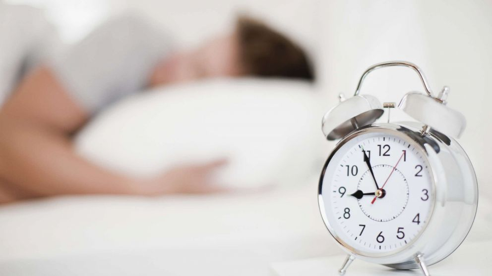 This stock image depicts a man sleeping.