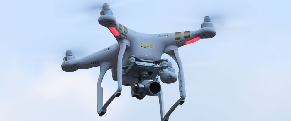 In this FILE photo, A drone flying over the crowd hovers in the air on June 14, 2015 .