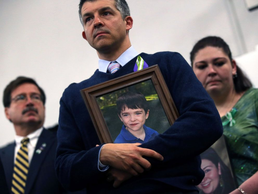 PHOTO: Ian Hockley holds a photo of his son, Dylan Hockley, during a press conference with fellow parents of victims on the one month anniversary of the Newtown elementary school massacre, Jan. 14, 2013, in Newtown, Conn.