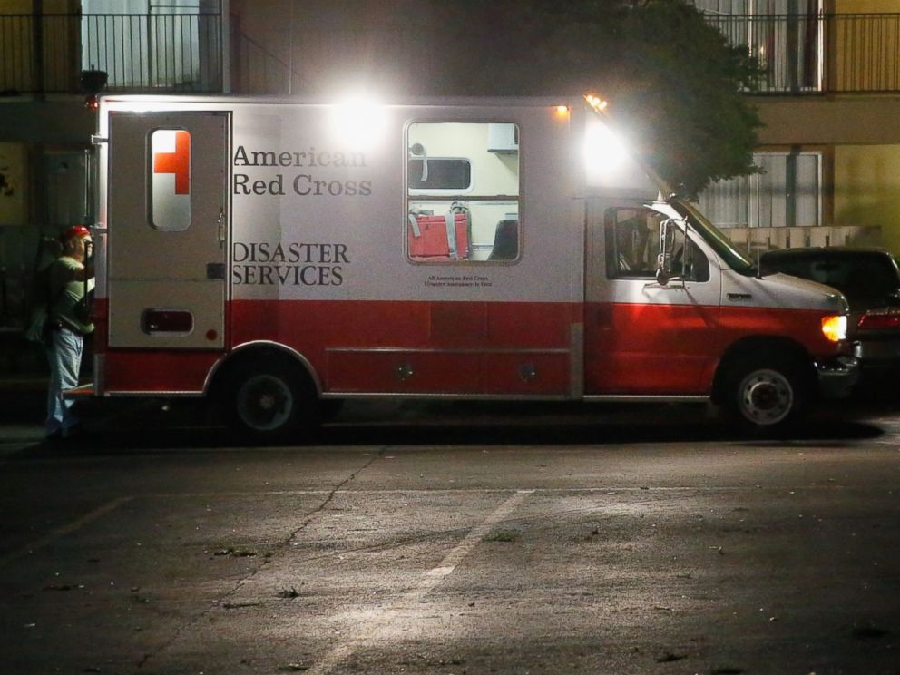 PHOTO: Volunteers from the Red Cross deliver blankets and other supplies to a unit at the Ivy Apartments, where the confirmed Ebola virus patient was staying, on Oct. 2, 2014 in Dallas, Texas.