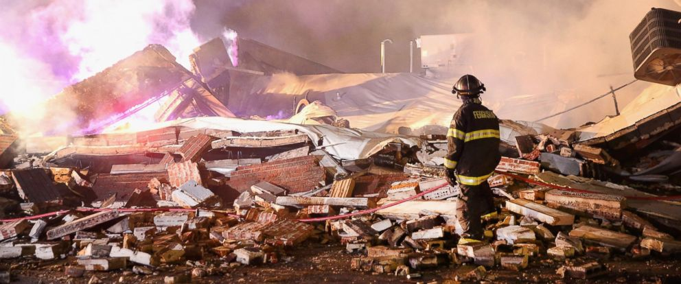 PHOTO: A Ferguson firefighter surveys damage to a strip mall that was set on fire when rioting erupted following the grand jury announcement in the Michael Brown case, Nov. 25, 2014 in Ferguson, Mo.