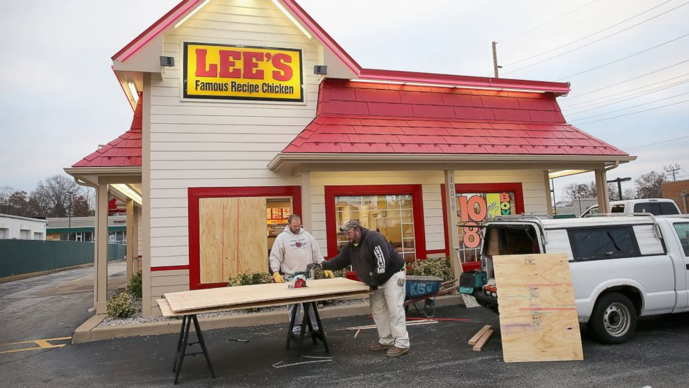 Workers board up a window of a restaurant after it was smashed when rioting erupted following the grand jury announcement in the Michael Brown case, Nov. 25, 2014 in Ferguson, Mo.
