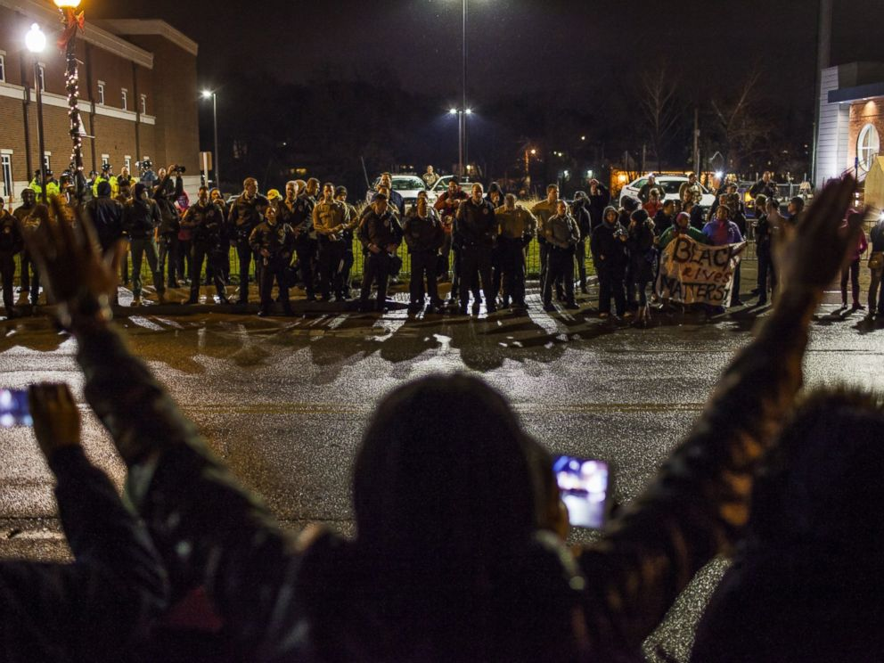 PHOTO: Protestors march in front of the Ferguson Police Department in Ferguson, Nov. 23, 2014.