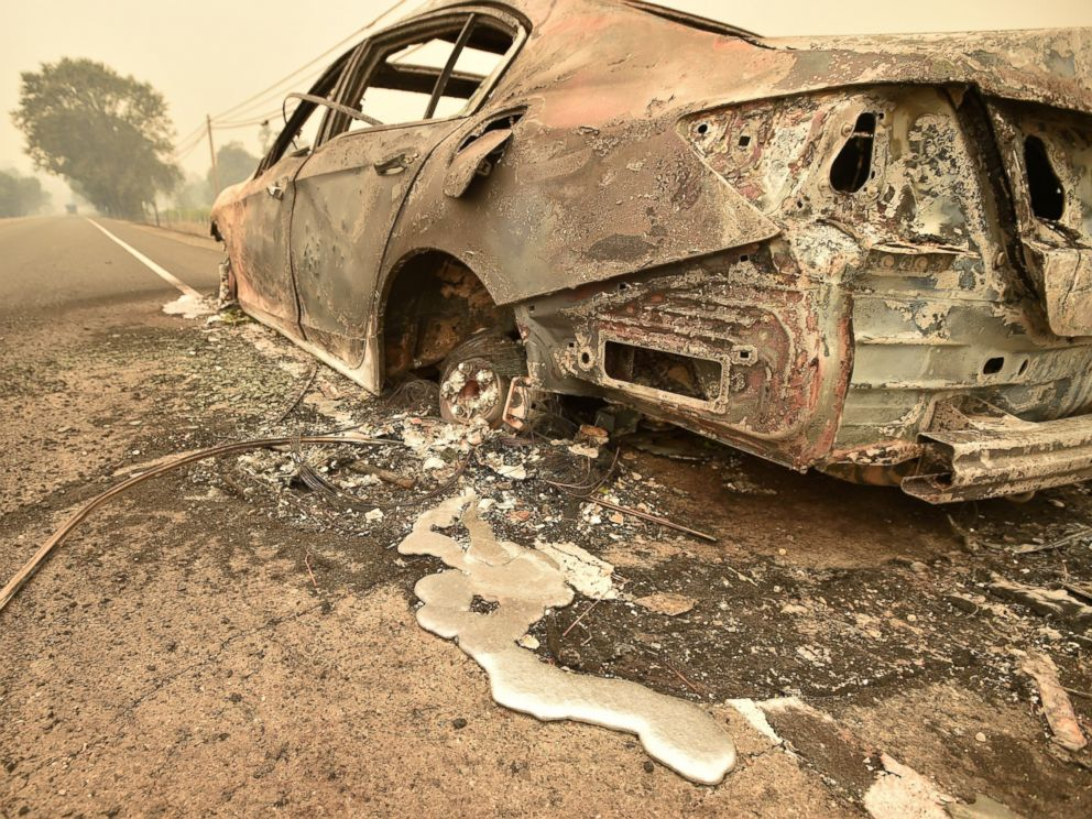 PHOTO: Melted metal flows from a burned out car abandoned on a highway near the Valley fire in Middletown, Calif., Sept. 13, 2015.
