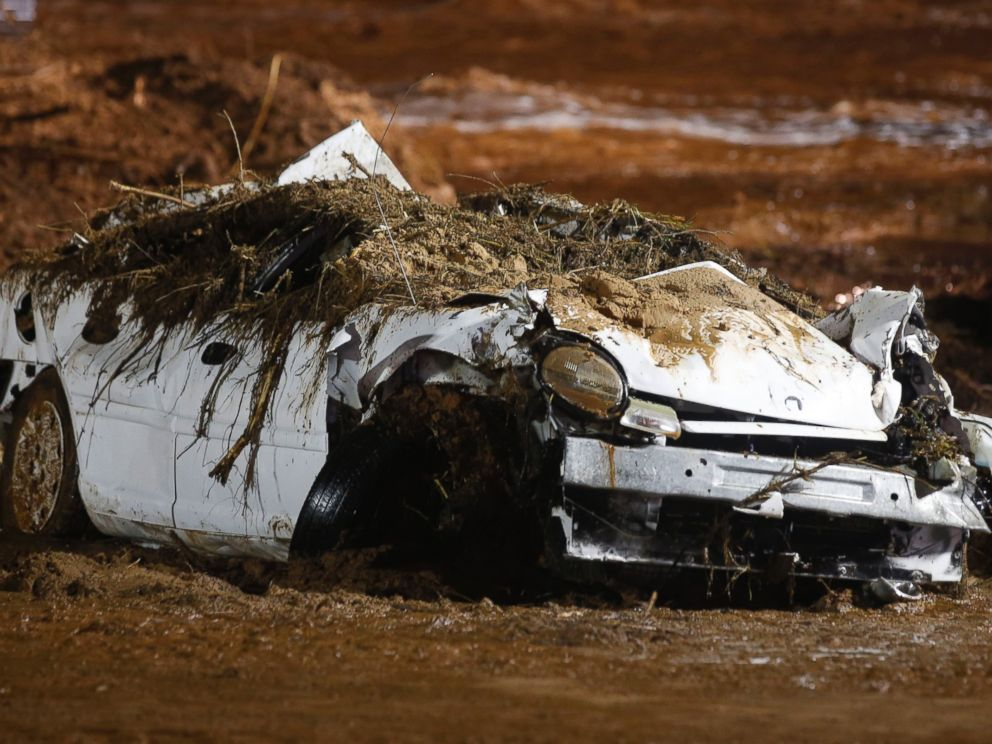 PHOTO: A car sits on the side of the road after being pulled from Short Creek by construction equipment that is removing flood debris from Short Creek as it crosses Central Street, Sept. 15, 2015 in Hildale, Utah