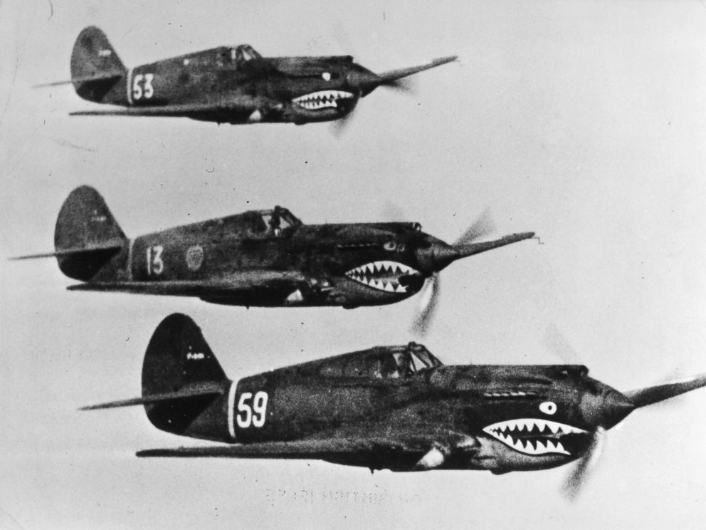 PHOTO: American Volunteer Group aircraft, known by the Chinese as flying tigers, flying in tight formation on the Far Eastern front, where they are aiding the Chinese Army against the Japanese.