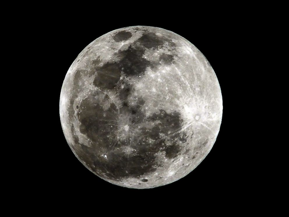 PHOTO: A full moon is seen before a total lunar eclipse in Bogota, Colombia, April 15, 2012.