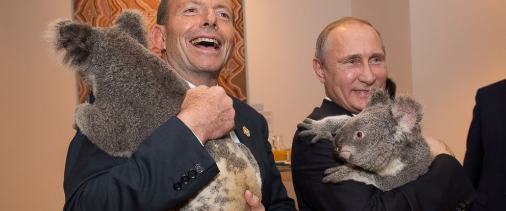 PHOTO: Australias Prime Minister Tony Abbott and Russias President Vladimir Putin