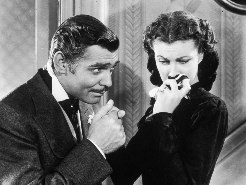PHOTO: American actor Clark Gable in his role as Rhett Butler kissing the hand of a tearful Scarlett OHara, played by Vivien Leigh in Gone With the Wind.