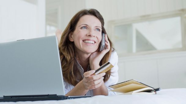 PHOTO: A woman looks happy while making a purchase over the phone in this undated file photo.