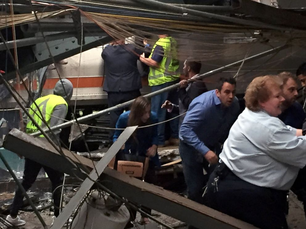 PHOTO: Passengers rush to safety after a NJ Transit train crashed in to the platform at the Hoboken Terminal, Sept. 29, 2016, in Hoboken, New Jersey.