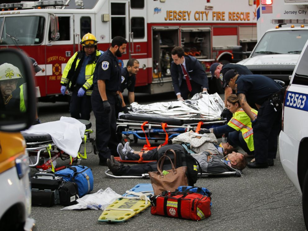 PHOTO: People are treated for their injuries outside after a NJ Transit train crashed in to the platform at Hoboken Terminal, Sept. 29, 2016, in Hoboken, New Jersey.