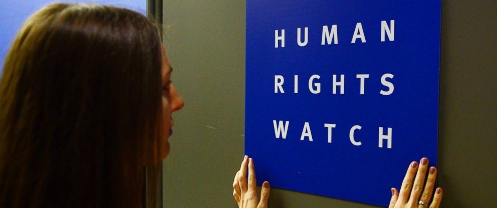 PHOTO: A woman puts a logo of US-based rights group Human Rights Watch on the door as she prepares the room before their press conference to release their annual World report in this Jan 21, 2014 file photo in Berlin.