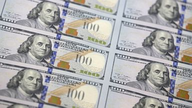 PHOTO: A sheet of uncut $100 bills.