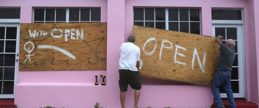 PHOTO: People put up plywood on a window as they prepare for Hurricane Matthew as it approaches the area, Oct. 6, 2016 in West Palm Beach, Florida.