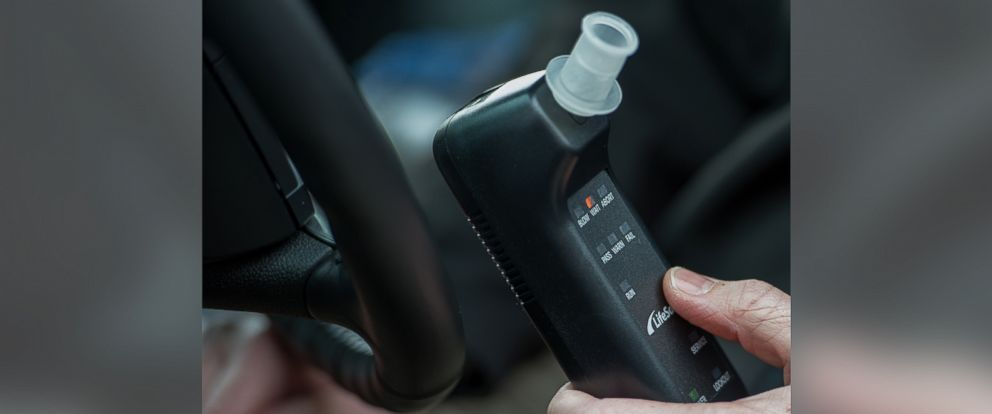 """PHOTO: Bill Chastain, State Director with LifeSafer, demonstrates a breath alcohol ignition interlock device during a """"Drive Sober or Get Pulled Over"""" press conference, Dec. 17, 2013 in Washington."""