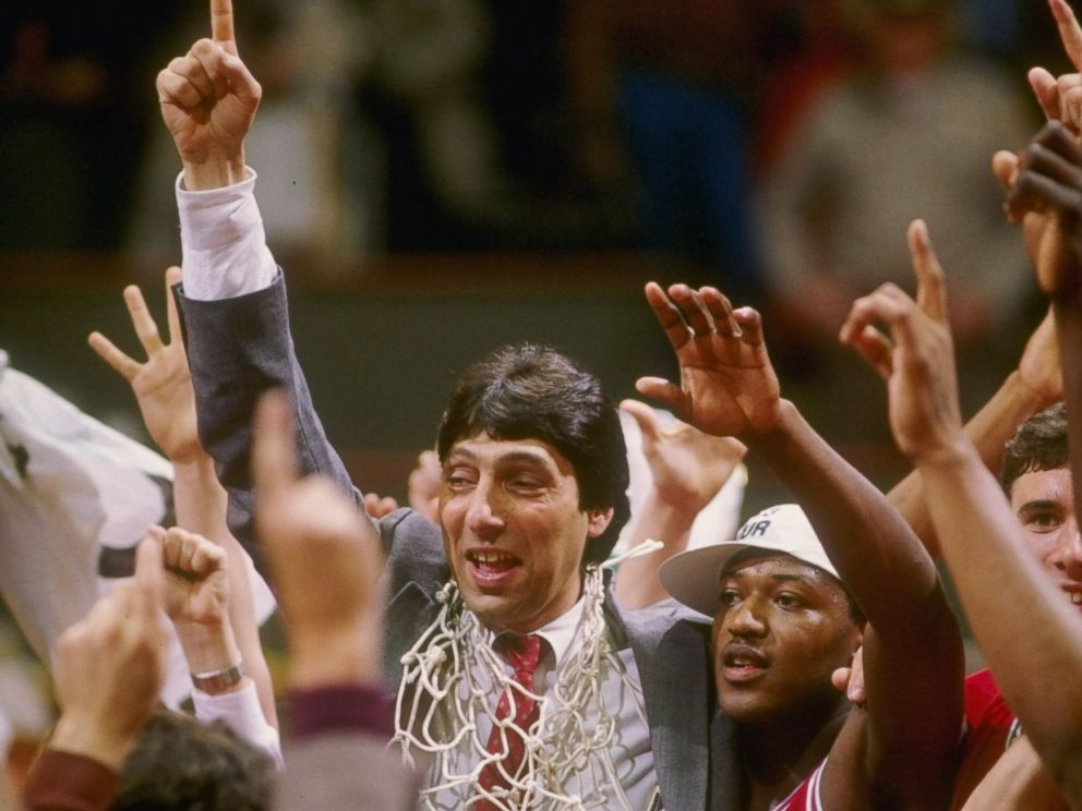 PHOTO: Head coach Jim Valvano of the North Carolina State Wolfpack celebrates with his team after the Wolfpack defeated the Houston Cougars 54-52 in the NCAA men's basketball championship game at University Arena in Albuquerque, New Mexico.