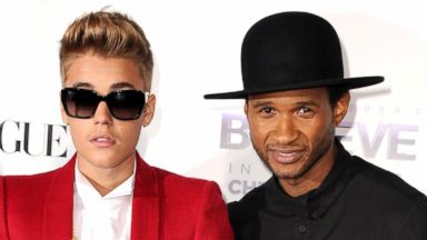 """PHOTO: Justin Bieber and Usher arrive at the """"Justin Biebers Believe"""" World Premiere at Regal Cinemas L.A. Live in Los Angeles, Dec. 18, 2013."""