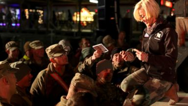 PHOTO: Kellie Pickler signs autographs after performing for U.S. service members as part of USOs holiday tour, in Kandahar, Afghanistan, Dec. 25, 2013.