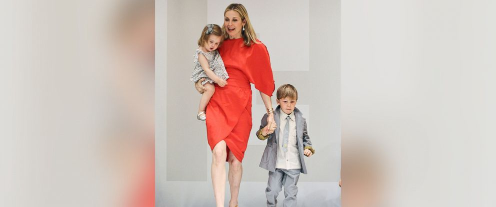 PHOTO: Kelly Rutherford, son Hermes, and daughter Helena walk the runway the Fendi Kids SS11 Domestic Debit Fashion presentation on April 14, 2011 in New York City.