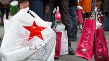 PHOTO: People wait to cross the street after shopping at Macys department store, Dec. 26, 2012, in New York City.