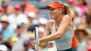 PHOTO: Maria Sharapova of Russia returns a shot against Caroline Wozniacki during the womens singles fourth round match at the 2014 US Open, Aug. 31, 2014, in New York City.