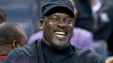 PHOTO: Michael Jordan, owner of the Charlotte Bobcats, reacts after a call during their game against the Brooklyn Nets at Time Warner Cable Arena on Nov. 20, 2013 in Charlotte, N.C.