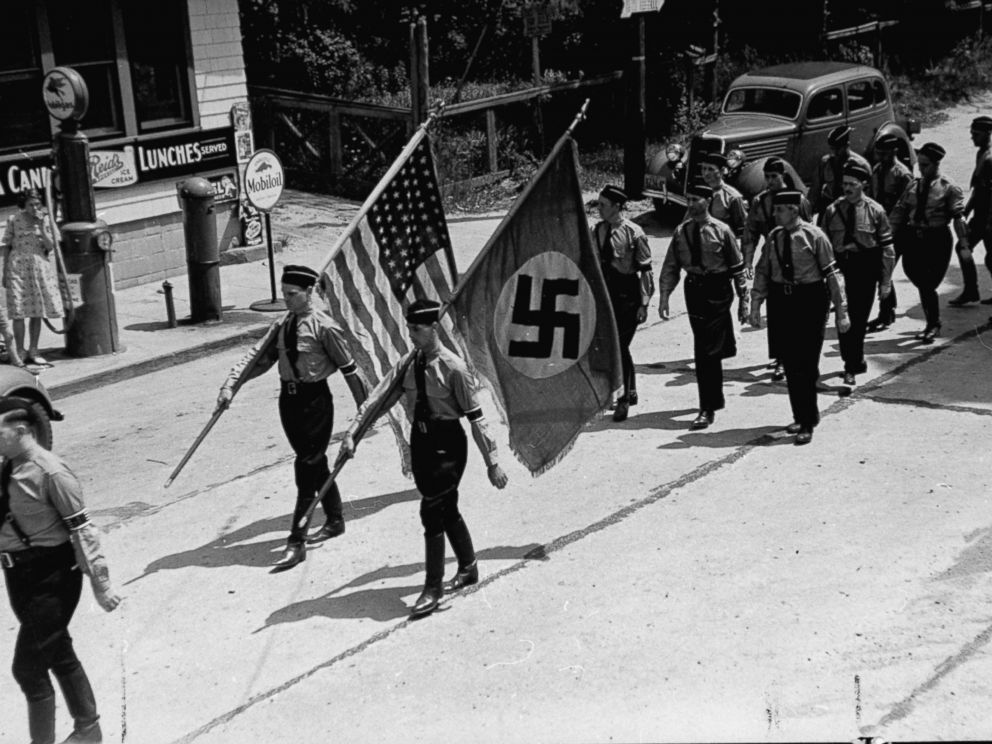 PHOTO:American Nazi party members march while carrying Nazi and American flags during a Bund outing from nearby Camp Sigfried, Jan. 01, 1937.