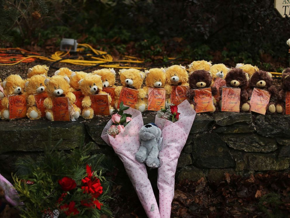 PHOTO: Teddy bears and flowers, in memory of those killed, are left at a memorial down the street from the Sandy Hook School on Dec. 16, 2012 in Newtown, Conn.
