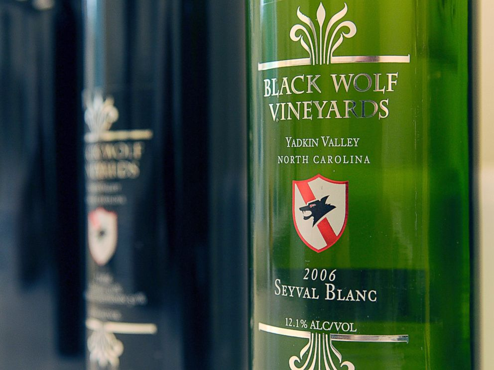 PHOTO: Bottles of Black Wolf Vineyards wine sit in the winery lab for inspection by potential bidders during the vineyard auction in Dobson, North Carolina, Aug. 20, 2010.