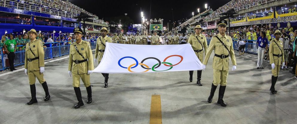 PHOTO: Honor guards carry the Olympic flag before the performance of the Vila Isabel samba school during the second night of the carnival parade at the Sambadrome in Rio de Janeiro, Feb. 8, 2016.