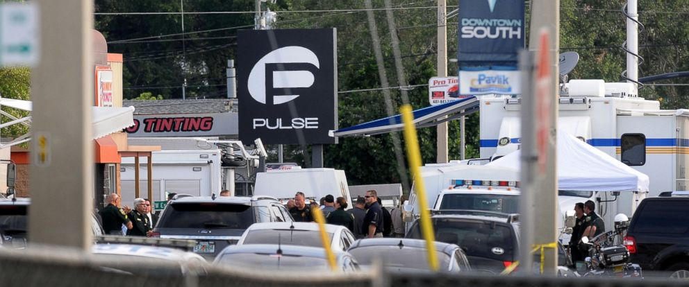 PHOTO: Orlando police officers are seen outside of Pulse nightclub after a fatal shooting and hostage situation on June 12, 2016 in Orlando, Fla.
