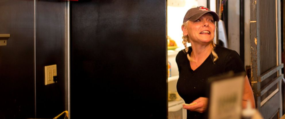 PHOTO: Darla Neugebauer, owner of Marcys Diner, works the grill, July 22, 2015 in Portland, Maine.