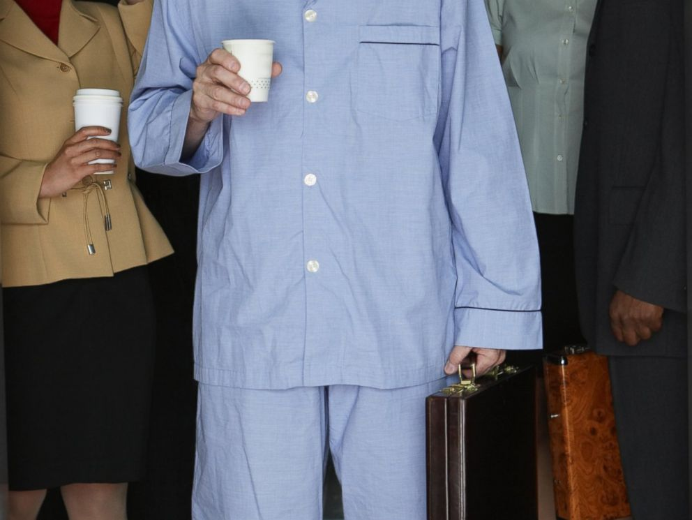 PHOTO: A man wears pyjamas standing in an elevator.