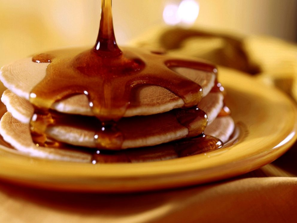 PHOTO: Pancakes topped with maple syrup.